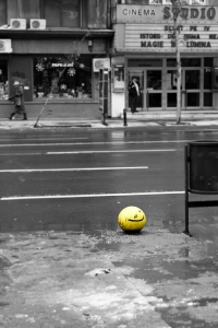 Yellow smiley on street