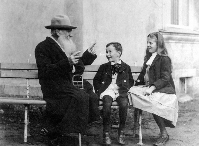 Leo Tolstoy telling his grandchildren a story.
