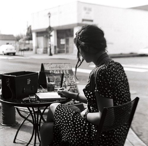 woman writing black and white