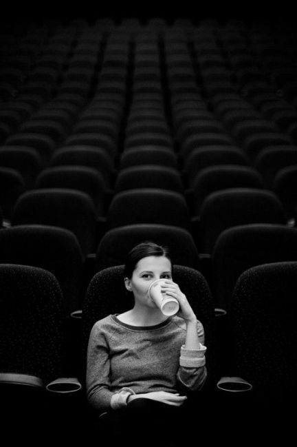 woman alone at cinema film black and white photograph