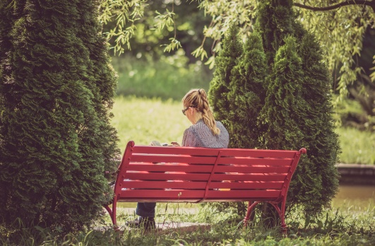 woman on bench reading