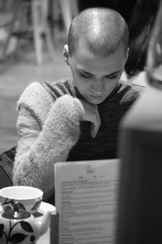 woman reading short haircut