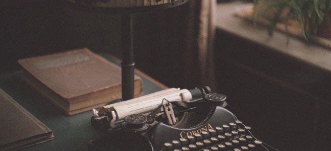 corona typewriter machine on desk