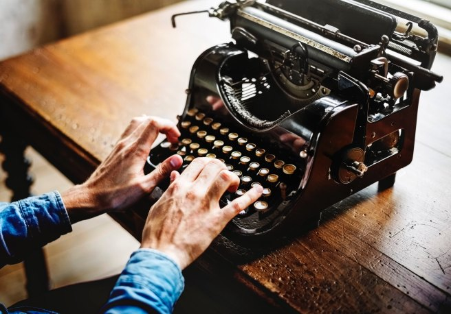How to write more - man typing old typewriter