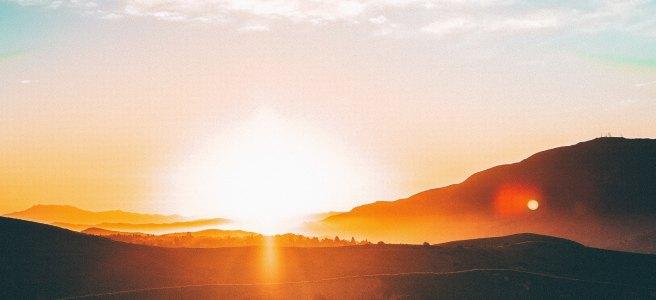 Sunset over hills. blue sky