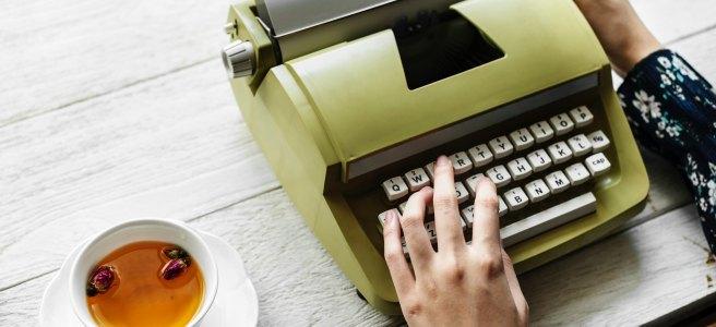 Woman writing typewriter